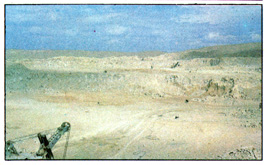 The open pit mine at the deposit of the cement raw materials