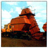 THE HARVESTING MACHINE OF THE HOPPER TYPE